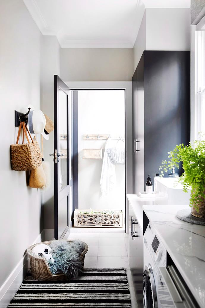 It may be narrow, but clever design and ample storage make this laundry room streamlined and functional.