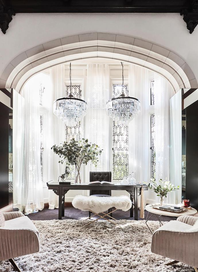 Chandeliers from The Bronte Tram. Curtains, The Art of Windows. Velvet-covered armchairs, Roar+Rabbit. Antique Chinese table (used as desk). Horse sculpture by Natus Rademeyer. The coffee table was a market find in Austria.