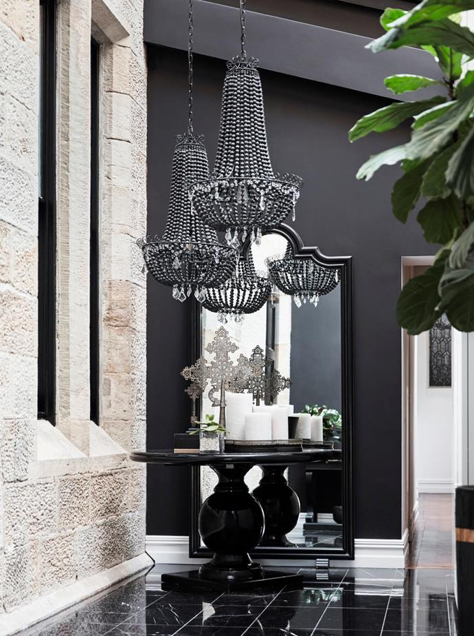 Mirror and clay-bead pendant lights from The Art of Windows. The antique table is from The Philippines, decorative cross from Ethiopia.