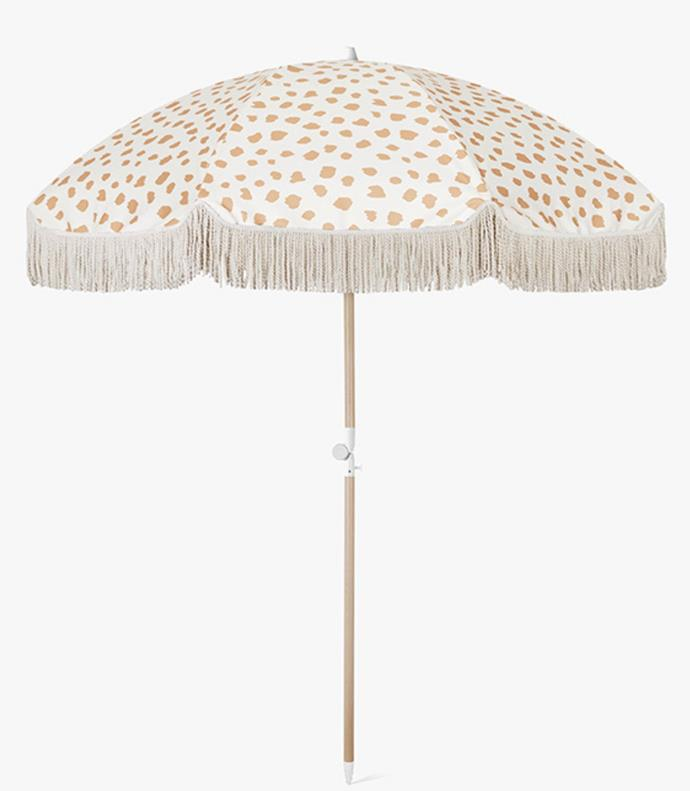 """This stylish umbrella will keep you and your guests from frying when dining outdoors. Shading an area of up to four metres, the canopy provides great shade for small and large groups. <br><br>Golden Sands Beach Umbrella By Sunday Supply Co, $249, [Aura Home](https://www.aurahome.com.au/beach-umbrella-golden-sands-jpg target=""""_blank"""" rel=""""nofollow"""")"""