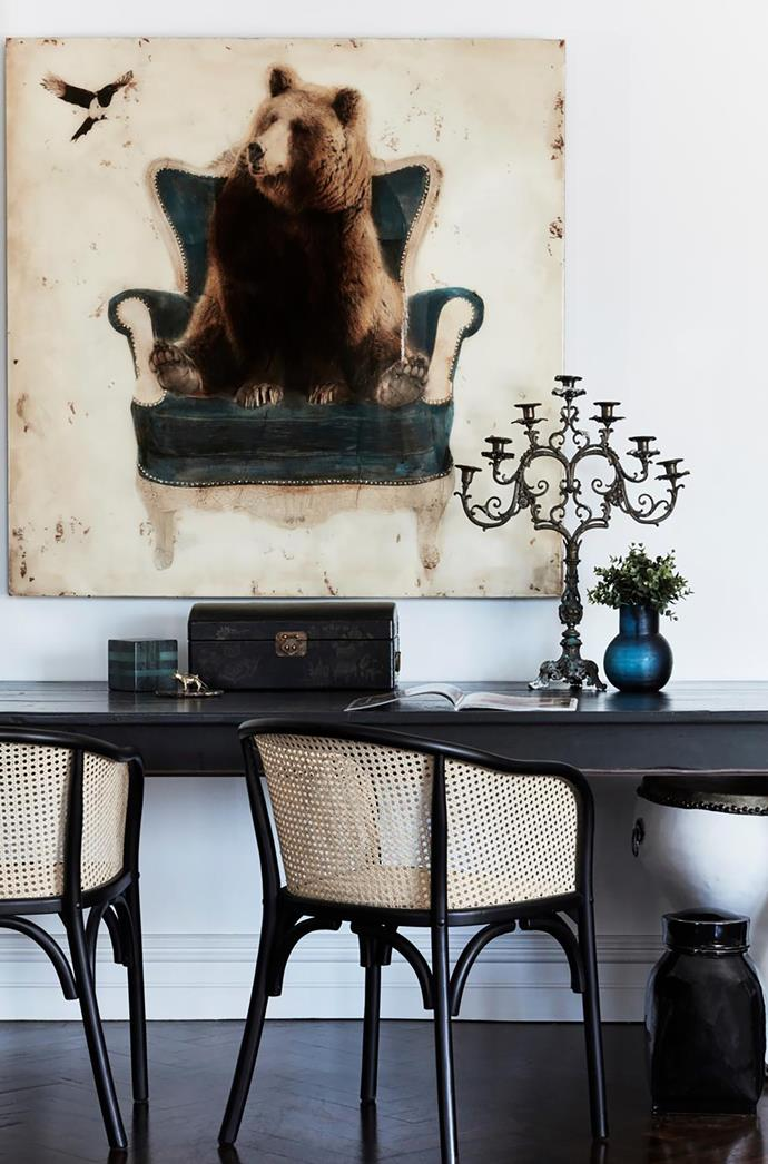 A bear painting purchased in the US presides over the homework spot in the living area.