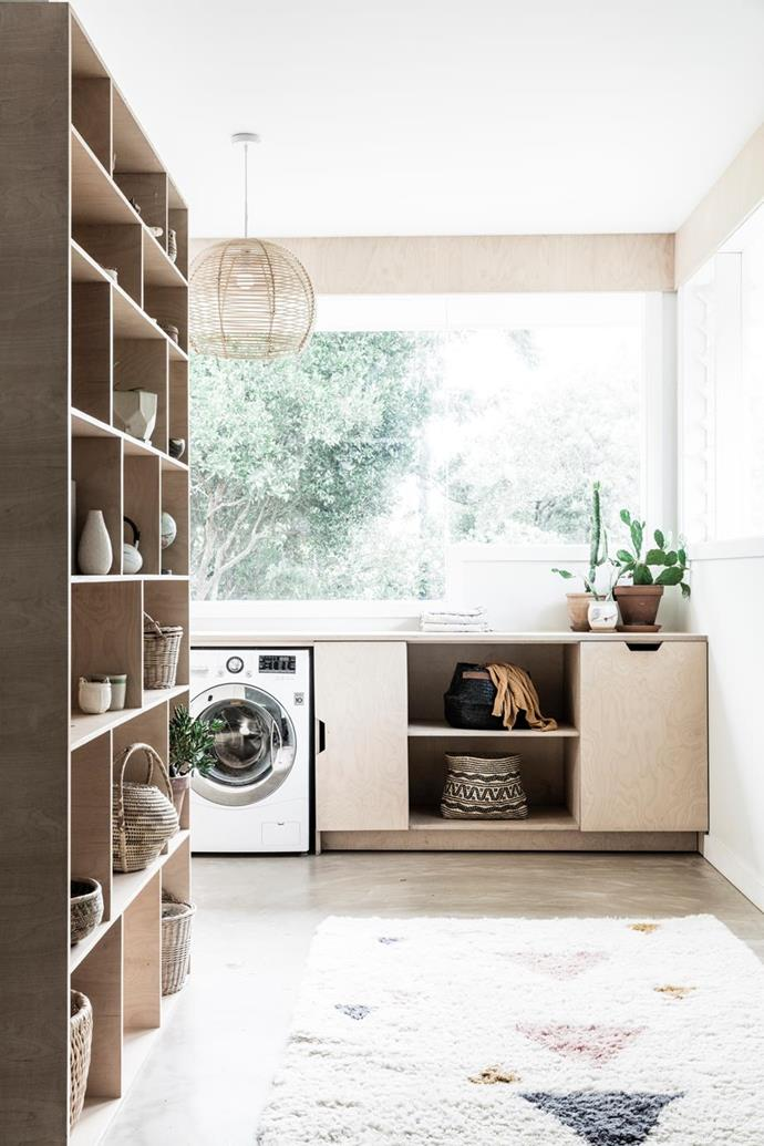"A collection of plants, baskets and flea-market knick-knacks sit on the shelves of this bright and airy laundry in a revamped [1970s Byron Bay bungalow](https://www.homestolove.com.au/a-1970s-byron-bay-bungalow-updated-with-hygge-style-6983|target=""_blank"")."