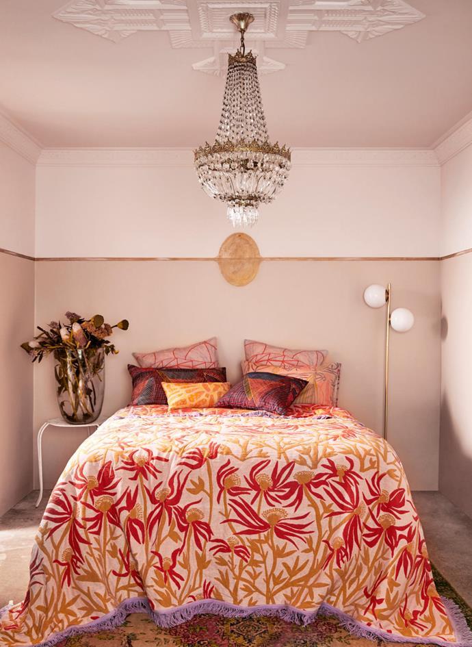 Deborah's Manwak woven cotton bedspread depicts the Manwak flower that grows near her homeland in central Arnhem Land.