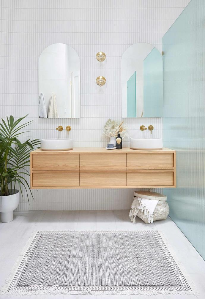 Luke and Jasmin's winning bathroom from The Block 2020 features white kit-kat tiles lined and fluted glass shower screens that added old-school glamour.