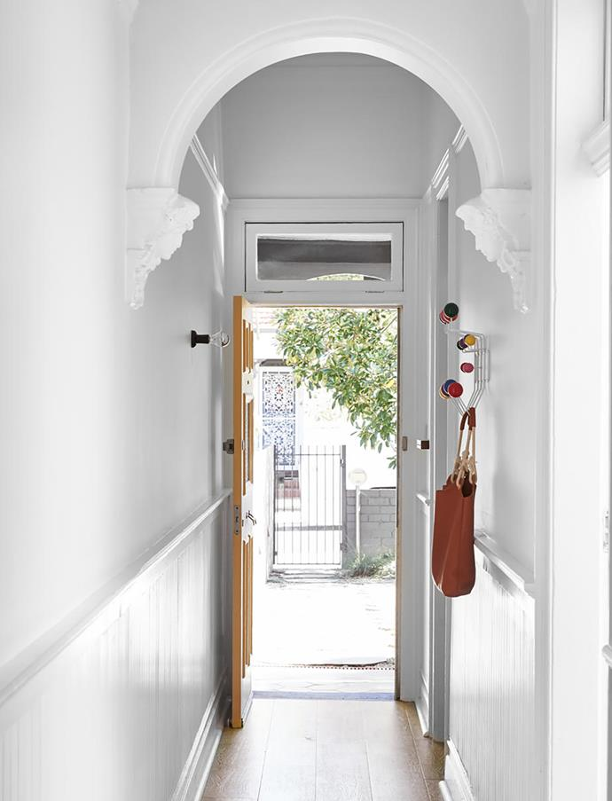"""""""I always recommend having a great coat hook and a place for keys just inside the front door,"""" says Carla. Eames 'Hang-It-All' coat rack, Living Edge. Hall painted Dulux Vivid White."""