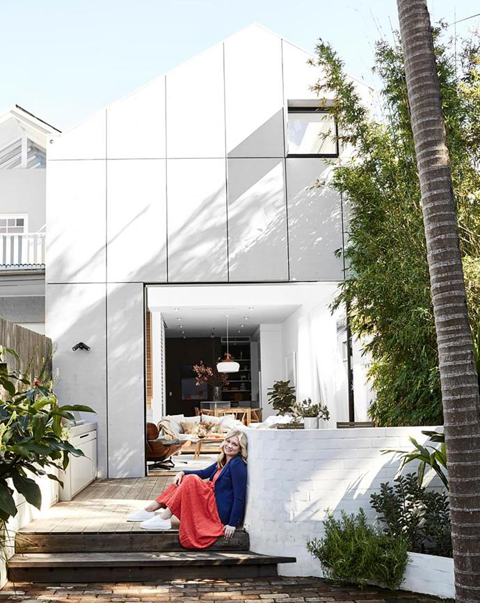 """It was all about gaining light and privacy and responding to the site,"" says Carla of her revamped family home. She chose James Hardie fibre-cement cladding for the rear extension as it is low maintenance for the beachside location. The garden, by Pepo Botanic Design, was designed around existing melaleuca and palm trees with bamboo for privacy. Waratah setting, Eco Outdoor. Femob 'Bellevie' bench in Cactus, Design Nation. Spotted-gum decking."