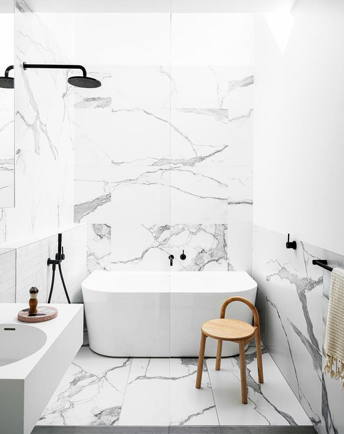 Aura bath, Caroma. I Classici 'Statuario' wall and floor tiles and Kit Kat Luminoso gloss tiles, Di Lorenzo Tiles. Omvivo 'Neo' vanity, Reece. City Stik tapware, Brodware.