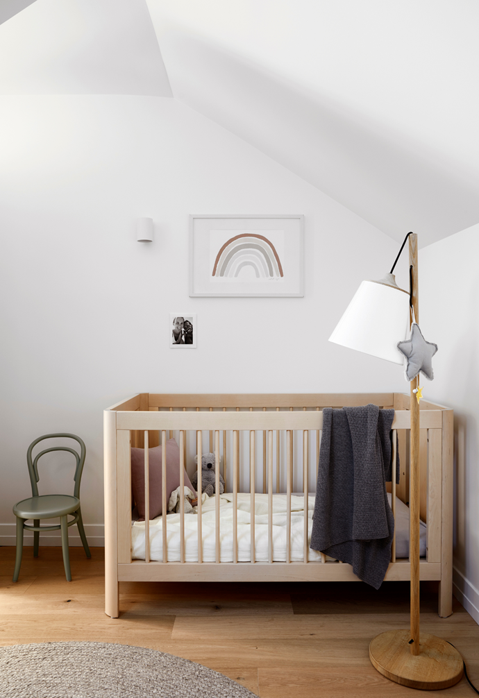 "In the nursery the mobile hanging from the lamp plays Let It Be by The Beatles. ""It has become our son's favourite song,"" Cushla says. The James Richardson chair, Danish by Design cot, Muuto lamp and Armadillo & Co rug create a soothing, functional space."