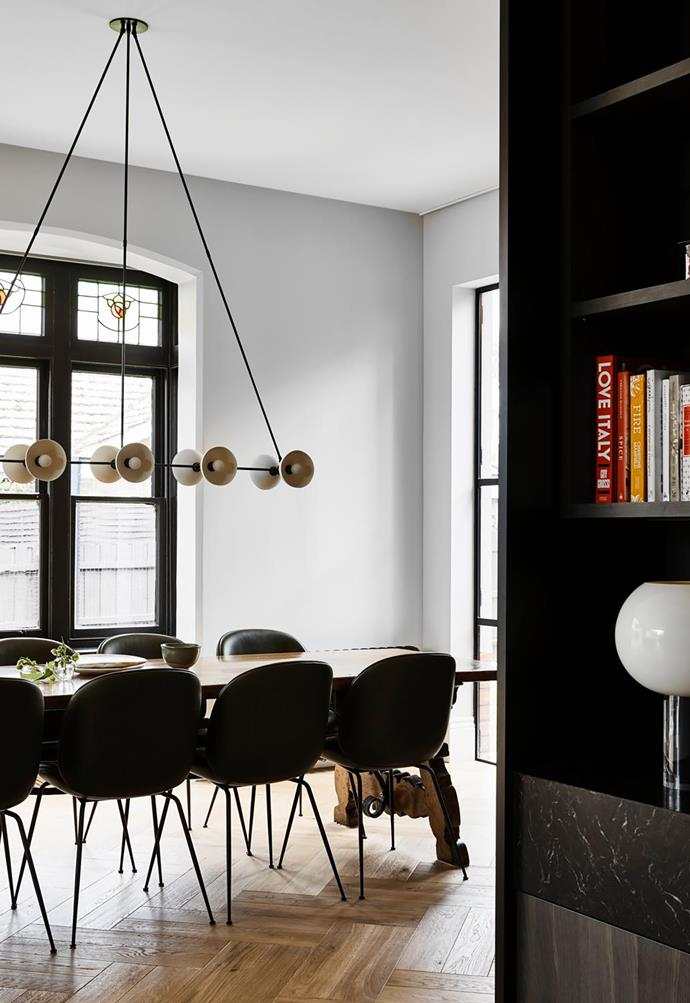 The dining area includes an Edwardian leadlight window. An Apparatus 'Trapeze 10' pendant light from Criteria illuminates the table and chairs. Foscarini 'Buds 3' table lamp from Space.