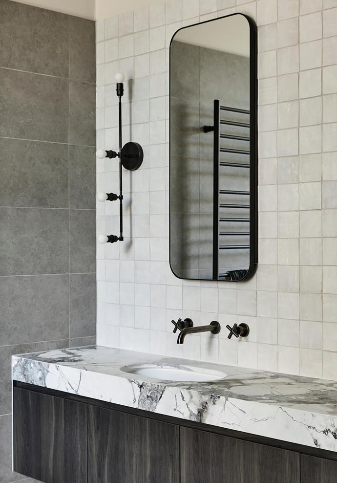 The main ensuite features Cote D'Azur marble on the vanity from CDK Stone. Apparatus sconce in brass from Criteria.