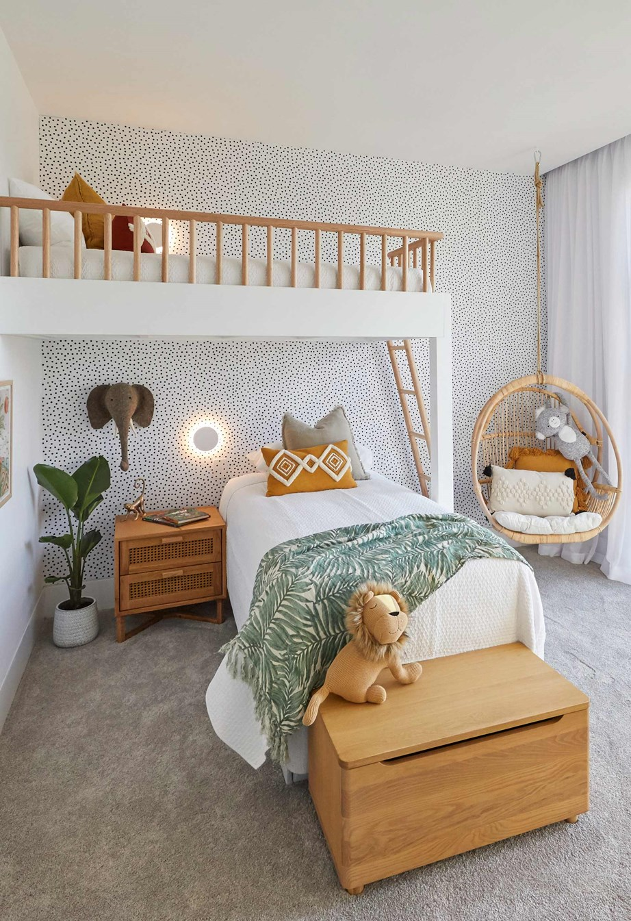 **Week 5, Upstairs Bedroom** The jungle-themed kids' bedroom that Luke and Jasmin were accused of copying features a custom-made bunkbed, cane hanging chair and wall paper feature wall.