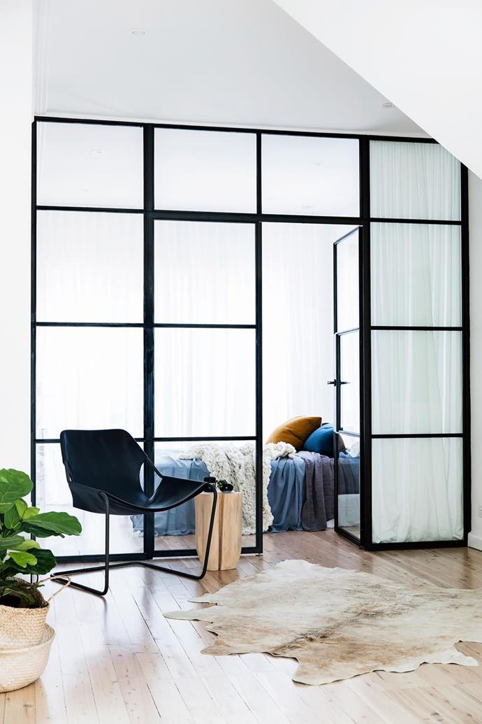 """The owners were keen to use black steel-framed windows to create a multifunctional space used as a fourth bedroom, study and playroom for this [Sydney beach home renovated by interior designer Kristy McGregor](https://www.homestolove.com.au/expert-renovation-and-interior-design-advice-5811