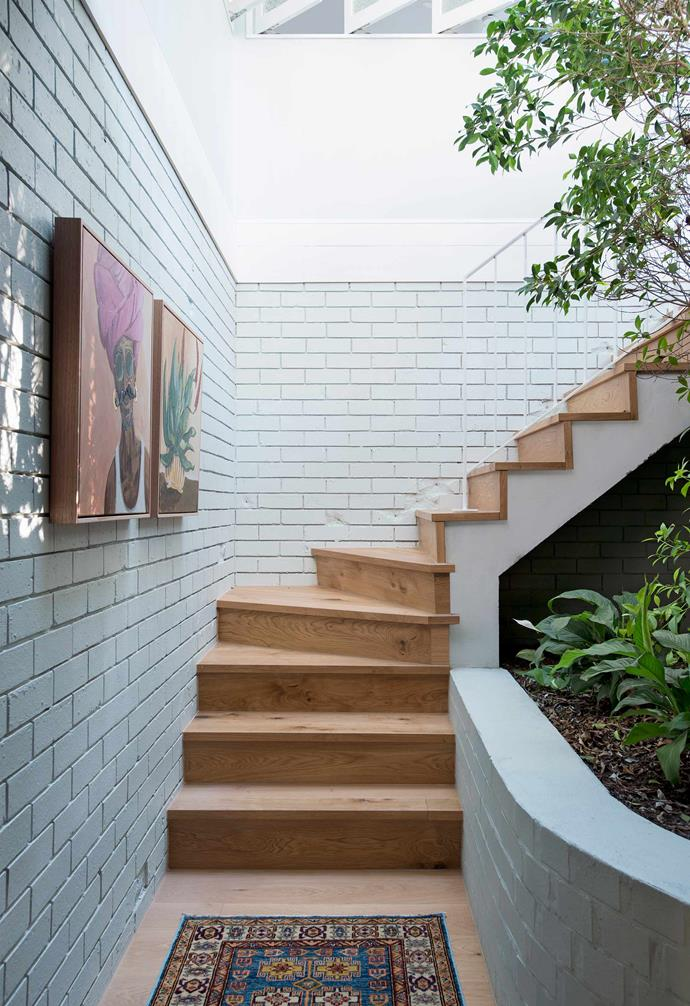 """**Staircase** This heads down to an as-yet-unfinished area below the main house. Artworks by Vynka Hallam from [Kira & Kira](https://kiraandkira.com.au/