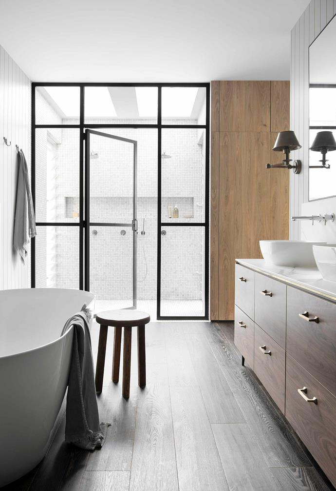 """**Ensuite** The black aluminium shower screen was made by a local welder. Vanity in [Laminex](https://www.laminex.com.au/