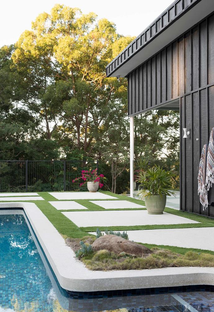 **Pool area** Restrained landscaping transforms the pool area into a dreamy oasis.