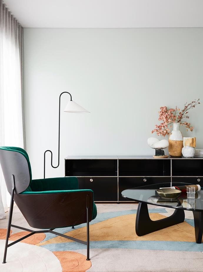 The cheery Quindalup rug is from The Rug Collection. SP01 'Caristo' armchair, Space. Eileen Gray 'Roattino' lamp and USM 'Haller' console, both Anibou. 'Ariel' alabaster sculpture by Carol Crawford. Vases, Spence & Lyda.