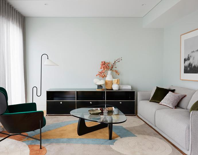 SP01 'Max' sofa and 'Caristo' armchair, Space. Noguchi coffee table, Living Edge. Whispering artwork by Elizabeth Bull from One Fine Print. Rug, The Rug Collection. Floor lamp and console, both Anibou. Ariel sculpture by Carol Crawford.
