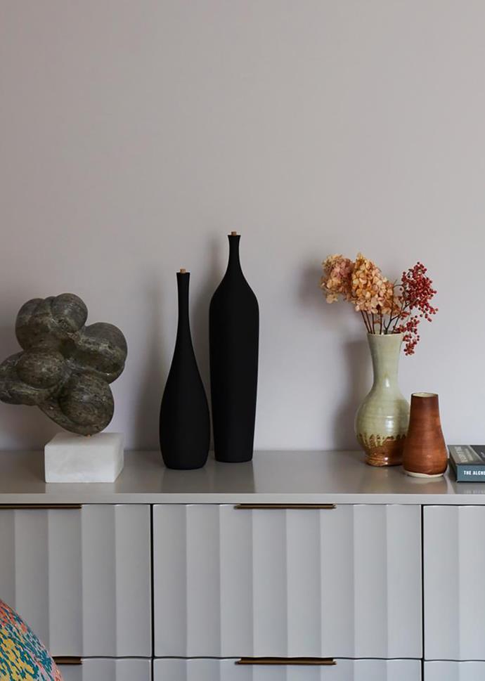 Vivien dresser, West Elm. Meshuggah sculpture by Carol Crawford. Bottles from Studio Cavit.Vases, Elph Store.