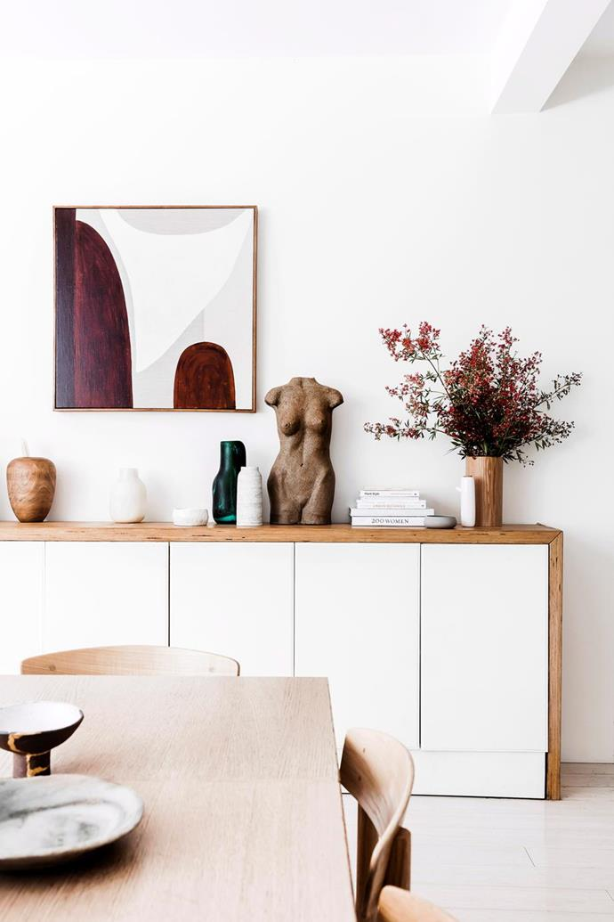 "The Hannah Nowlan artwork called Solar Sleeping Sun takes pride of place above the sideboard in the [Bondi home of Beauty Chef founder Carla Oates](https://www.homestolove.com.au/inside-the-beauty-chef-carla-oates-stunning-bondi-home-6292|target=""_blank""). Photo: Maree Homer"