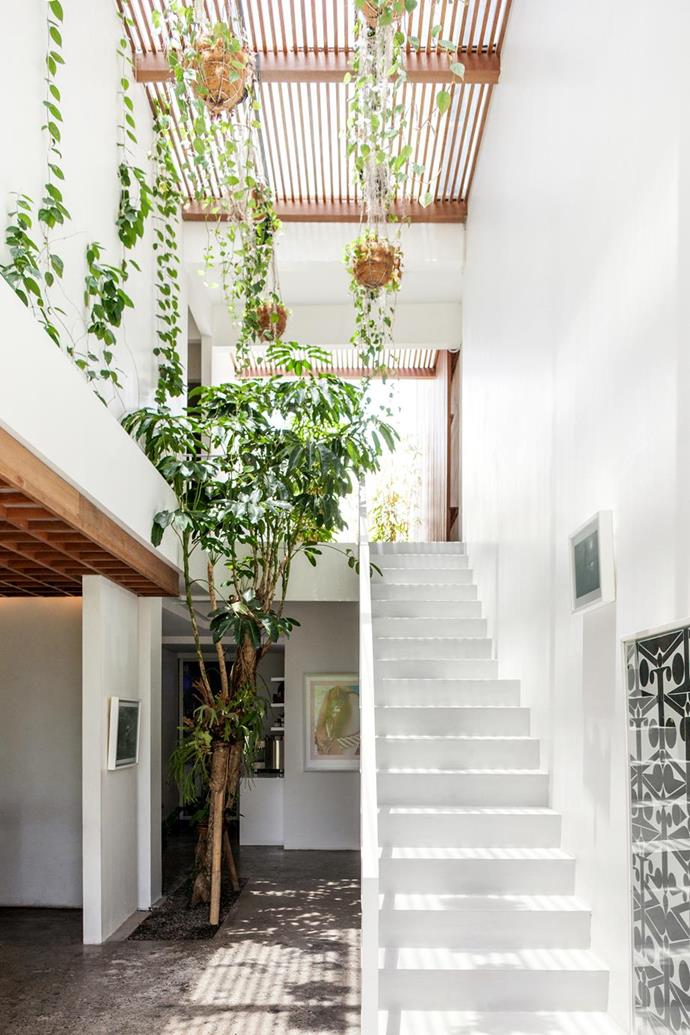 "The Slow, a highlight of [creatives in Bali](https://www.homestolove.com.au/creatives-guide-to-bali-6328|target=""_blank"") lets in plenty of light and lets nature take centre stage with pared back tones and polished concrete floors. Photo: Lynden Foss"