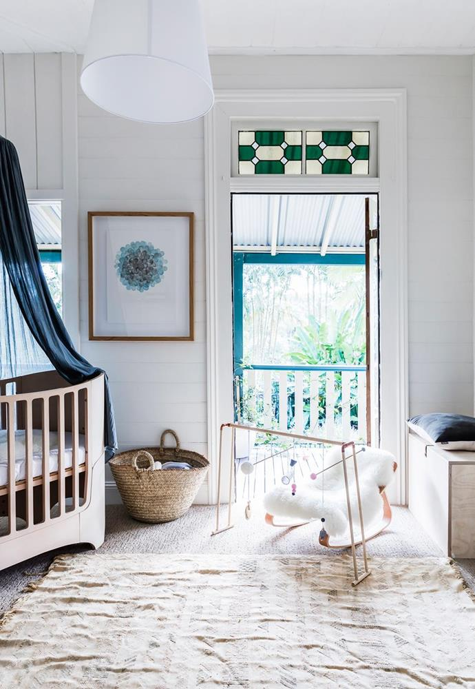 "Ophelia's room in Worn store co-founders [Lotte Barnes and Lia-Belle King's Byron Bay home](https://www.homestolove.com.au/minimalist-cottage-in-byron-bay-5881|target=""_blank"") blends minimalism and pieces that tell a story for a curated yet homely nursery, featuring a Leander cot, a Charlie Crane rocker, sheepskin rug from Worn and a mobile handmade by Lotte."