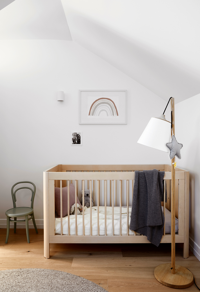 "In the nursery of interior designer Cushla McFadden's [minimal Victorian terrace](https://www.homestolove.com.au/minimal-victorian-terrace-sydney-21869|target=""_blank""), the mobile hanging from the lamp plays Let It Be by The Beatles. ""It has become our son's favourite song,"" Cushla says. The James Richardson chair, Danish by Design cot, Muuto lamp and Armadillo & Co rug create a soothing, functional space."