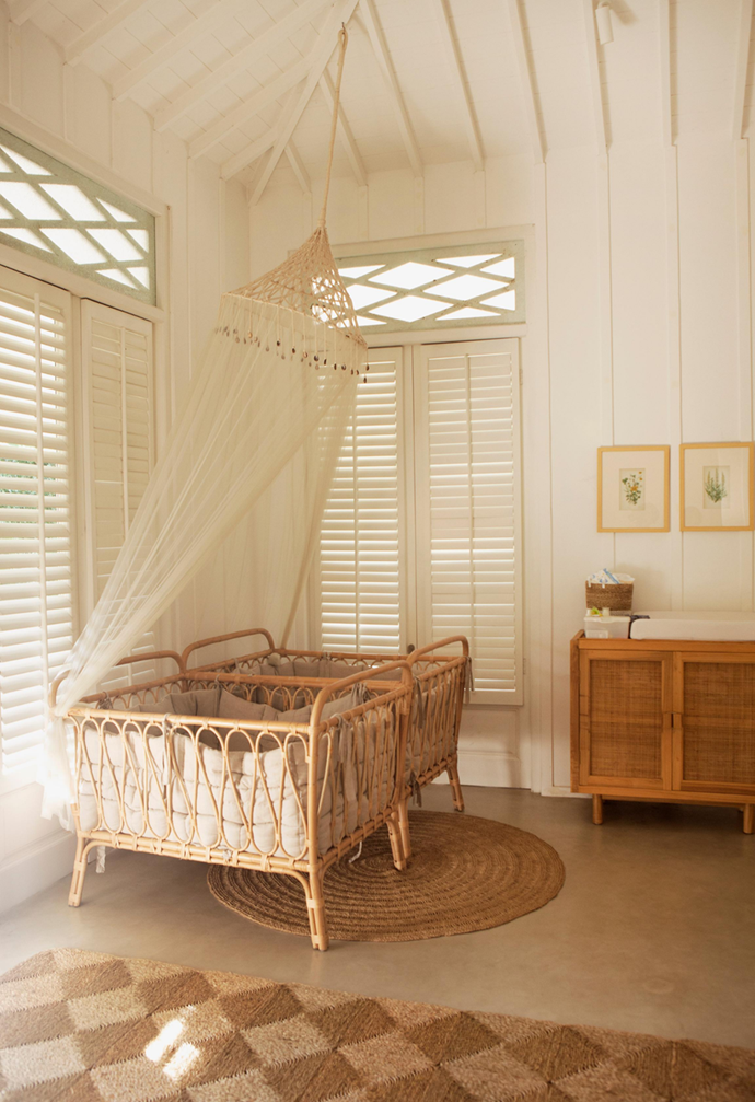 "Fashion designer Magali Pascal wanted the twins' room in [her Bali home](https://www.homestolove.com.au/magali-pascal-home-bali-21691|target=""_blank"") to feel soft and light, so she designed the teak and rattan furniture to fit in with the home's natural aesthetic. ""Kid's toys are usually very colourful so I wanted the nursery to be neutral and warm, with lots of cream tones and wooden accents."" Vintage French botanical prints and a mosquito net designed by Magali and made from cotton crochet and shells give the room a sweet and playful vibe."