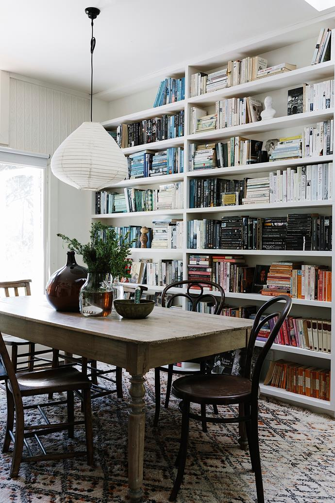 Lucie has installed shelving to house her book collection, while bentwood chairs flank a pre-loved table. Beni Ourain Moroccan rug bought online.