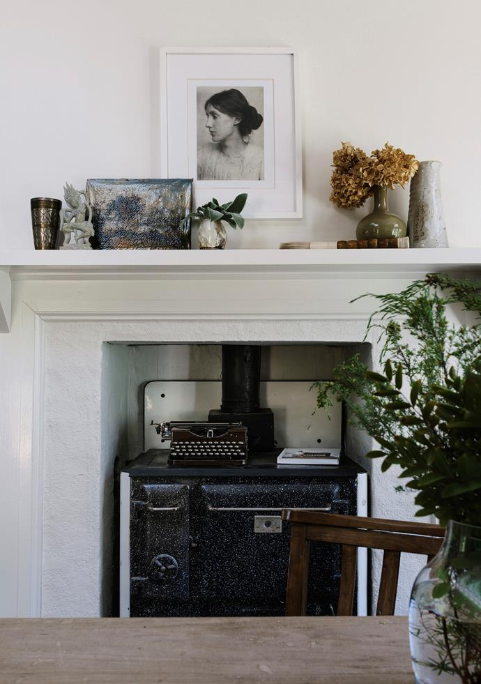 A portrait of Virginia Woolf sets a literary tone in the dining room. The original stove sits where the kitchen would have been.