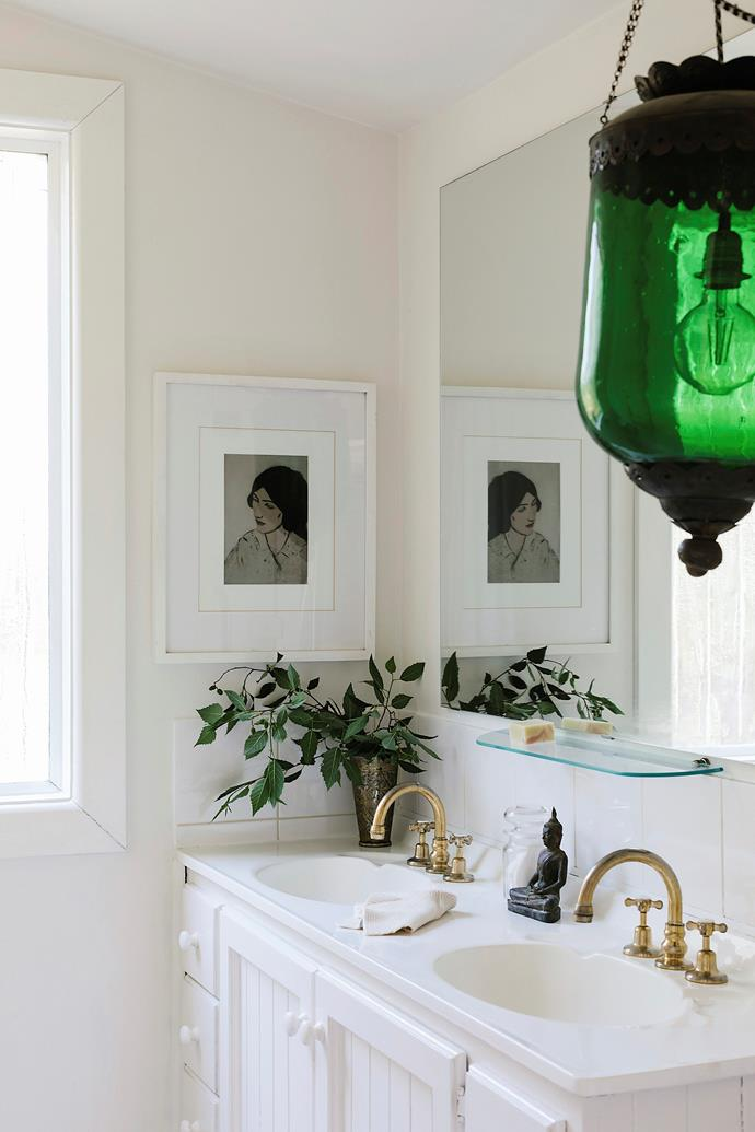 In the bathroom, Lucie added a green glass pendant, from an auction of artist David Bromley's pieces, and an artwork bought at the Auckland Art Gallery.
