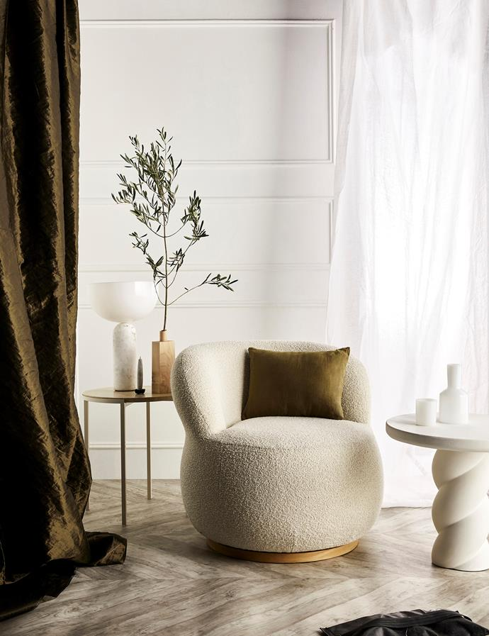 'Couture' curtain in Olive, $198/m, Mokum. 'Alice' table, $1908, Jardan. New Works 'Kizu' table lamp in White marble, $633, Finnish Design Shop. Takazawa 'Tohaku' candle, $32.50, and candle holder, $65/large, The DEA Store. Opus Lab 'Rock Maple' vase, $125, The DEA Store. Joy armchair in Luna/Eggshell, $2343, Jardan. 'Les Minis' pillow in Olive (on chair), $50, Cultiver. 'Twister' side table in Plaster White, $1495, Sophie Davies. 'J'ai Soif' carafe and glass in White, $79/set, Maison Balzac.
