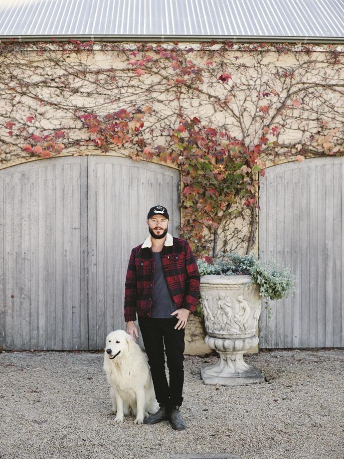 Winemaker Peter Windrim with his maremma sheepdog, Minty, outside the cellar door at Krinklewood Biodynamic Vineyard.