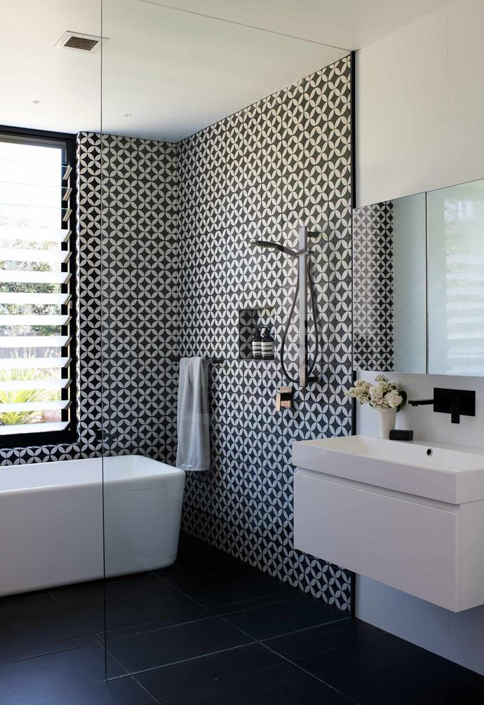 """**Main bathroom** A flower-pattern tile from [Coastal Tiles](https://www.coastaltiles.com.au/