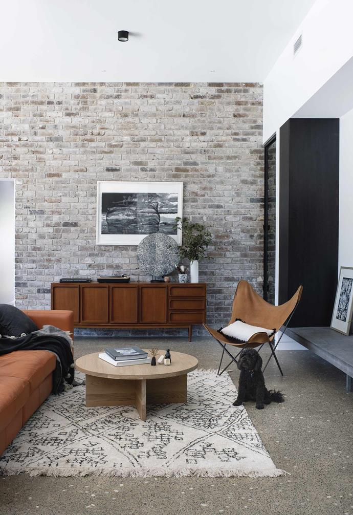 """**Living** """"The recycled brick wall was a last-minute addition I'm really pleased we ran with,"""" says Vanessa. """"It gives the space an unexpected warmth and presents as a beautiful textured backdrop for our artwork and Chiswick sideboard, which I bought through eBay."""" Sofa, [King Living](https://www.kingliving.com.au/