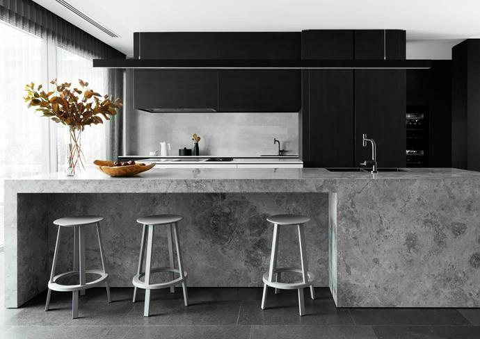 Timber-veneer joinery designed by Attila Roka and made by The Kitchen Studio IQ. Island bench made from Elias Silver limestone, Bernini Stone and Tiles. Revolver stools, DesignFarm. Slimline suspension light, Tilly's Lighting Solutions. Axor Citterio mixer tap, Sea of White.