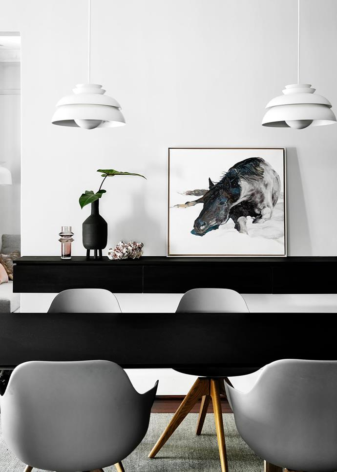 Pedrali 'Arki' dining table, Innerspace. Polo dining chairs, Contempo Studio. Floating wall unit by Attila Roka, made by The Kitchen Studio IQ. Concert pendant lights by Jørn Utzon, Cult. Artwork by Linda van der Merwe.