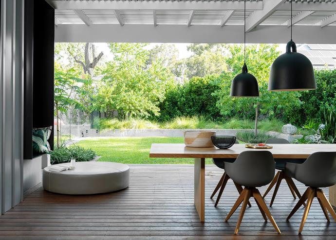 Sliding glass doors, Westec Doors and Windows. Dining table and Polo chairs, all Contempo Studio. Pendant lights, District. Puck ottoman, Henri Living. Teak decking, Mortlock Timber.