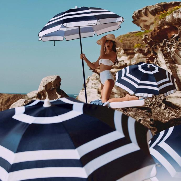 "Beach Umbrella, Dolce Classic, $89.95, [Sunnylife](https://www.sunnylife.com.au/products/beach-umbrella-dolce-classic|target=""_blank""