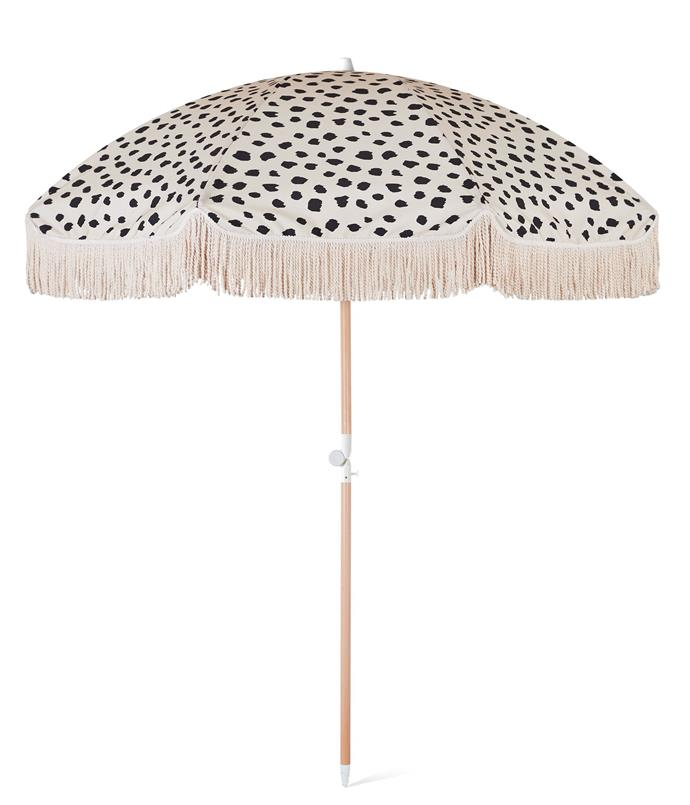 "Black Sands Beach Umbrella, $249, [Sunday Supply](https://sundaysupply.co/collections/shop/products/black-sands-beach-umbrella|target=""_blank""