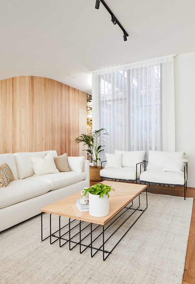 """**Week 7, Living Room** Continuing the white-on-white palette with timber accents in their [living and dining room](https://www.homestolove.com.au/the-block-2020-living-dining-reveal-21904