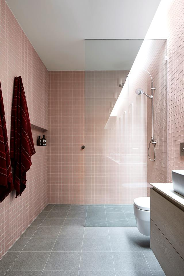 """Soft pink tiles elongate the bathroom walls adding graphic impact this this compact bathroom in a [converted garage-turned guesthouse](https://www.homestolove.com.au/converted-garage-guesthouse-21350