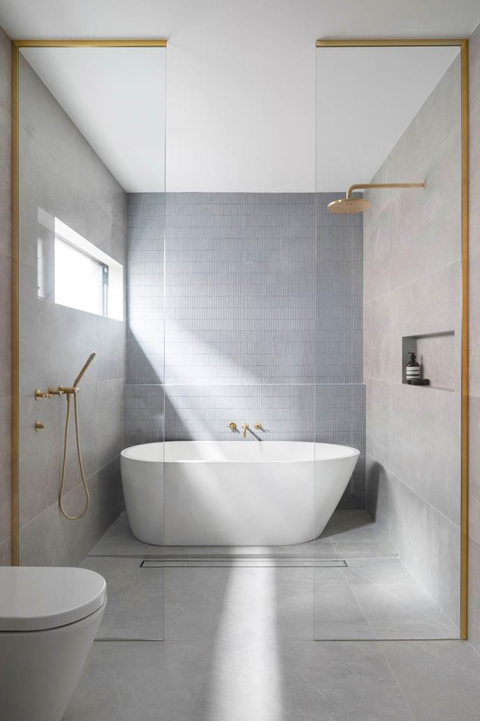 """Timeless finishes and a functional layout mean the bathroom is luxurious but still user-friendly in this [1970s family home](https://www.homestolove.com.au/bec-and-george-home-renovation-20669