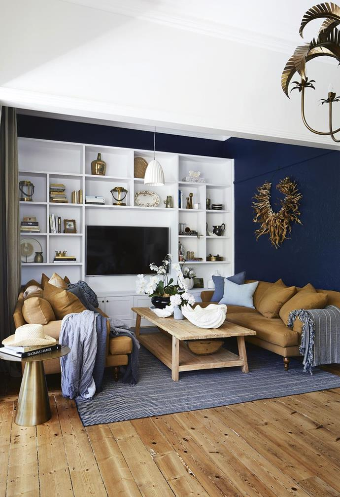 "One wall of the living room in [The Block's Dea and Darren charming seaside cottage](https://www.homestolove.com.au/the-blocks-dea-and-darren-renovated-this-charming-seaside-cottage-7035|target=""_blank"") is painted in bold Dulux Winter Sea. Photo: Armelle Habib 