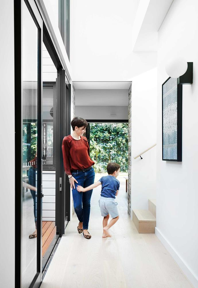 "**Hallway** Carolyn and her son in the void space. &Tradition 'Journey' wall light, [Cult](https://cultdesign.com.au/|target=""_blank""