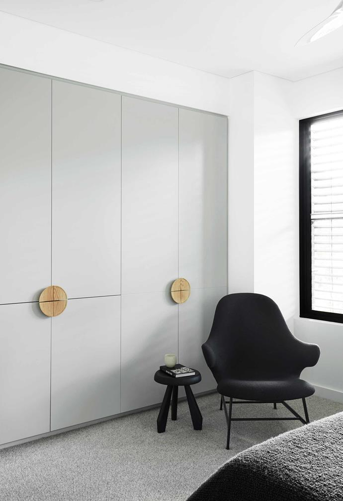 "**Main bedroom** A cosy armchair creates the perfect reading nook. Quattro surface-mounted American-oak door pulls from [In-Teria](https://interia.com.au/|target=""_blank""