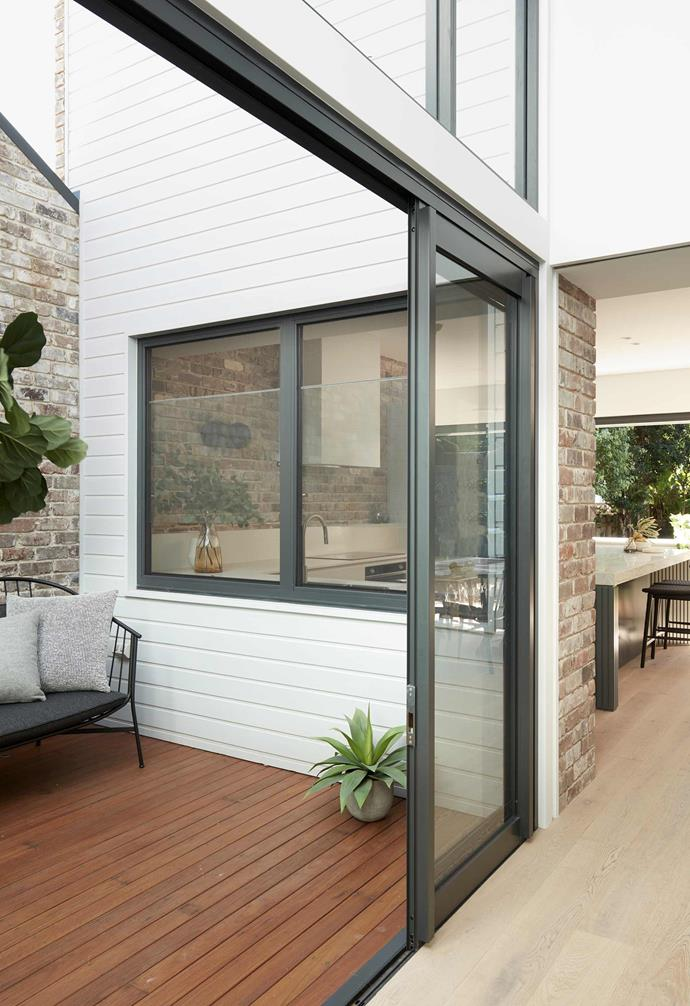 "**Internal courtyard** Spotted gum decking goes perfectly with the aluminium doors and windows from [Hanlon Windows](https://www.hanlonwindows.com.au/|target=""_blank""
