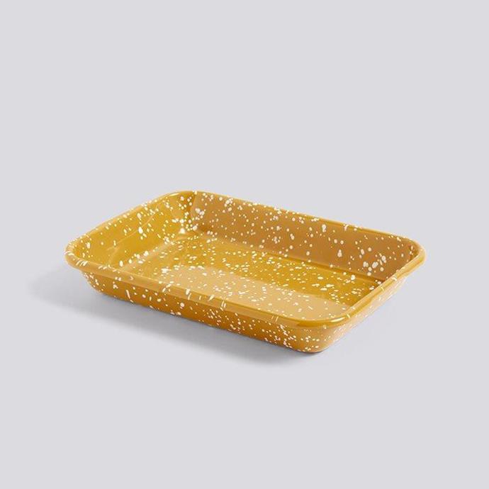 "Enamel Rectangular Tray in Speckle Mustard, $65, [Hay](https://hayshop.com.au/products/enamel-tray-rectangular-speckle-mustard?_pos=3&_sid=2f0aeab07&_ss=r target=""_blank"" rel=""nofollow"")."