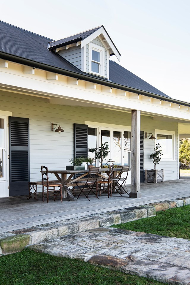 "While the stone pathway and weathered timber details give the impression that this [French-inspired farmhouse](https://www.homestolove.com.au/modern-farmhouse-french-interior-21917|target=""_blank"") is one-hundred years old, it's really a new build that reached construction completion in 2018."