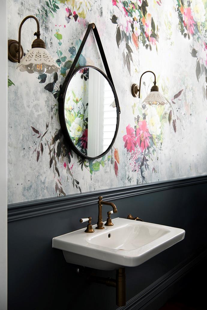 Designers Guild wallpaper lines a bathroom.