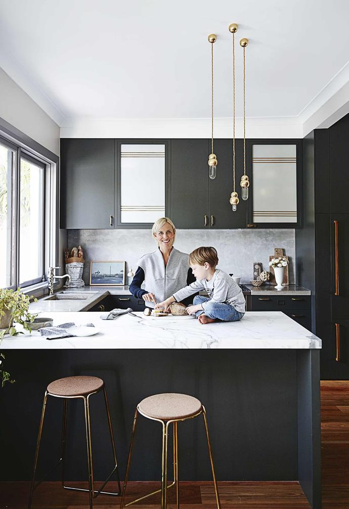 """**Kitchen** """"I spend a lot of time here,"""" says owner Claire Delmar, who incorporated two striped panels from a vintage door into the cabinets. """"They were offcuts that I could insert in there to give the space another element,"""" she says."""